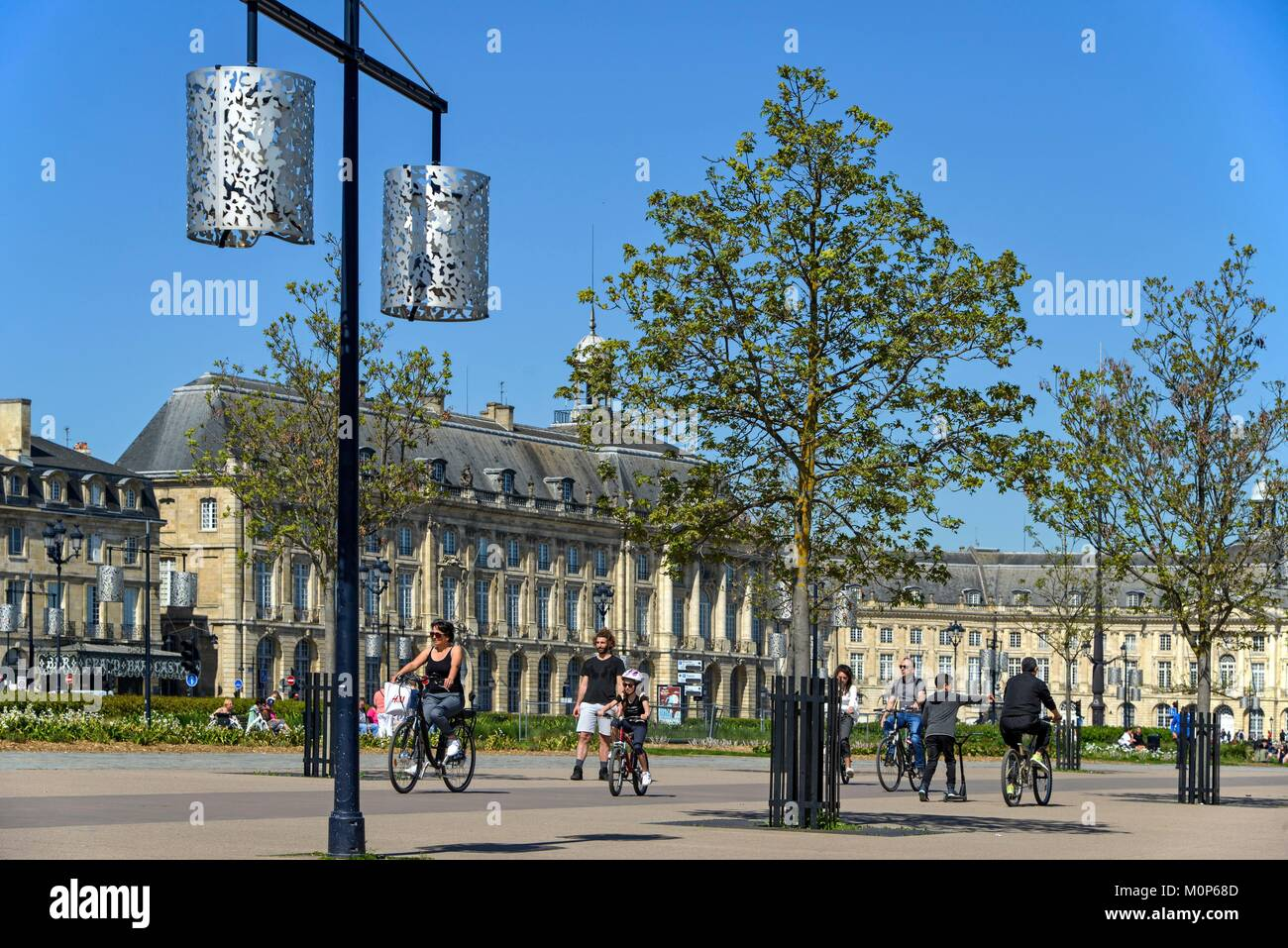 France,Gironde,Bordeaux,Quay of the Douane,goes and comes from cyclist on a pedestrian path - Stock Image