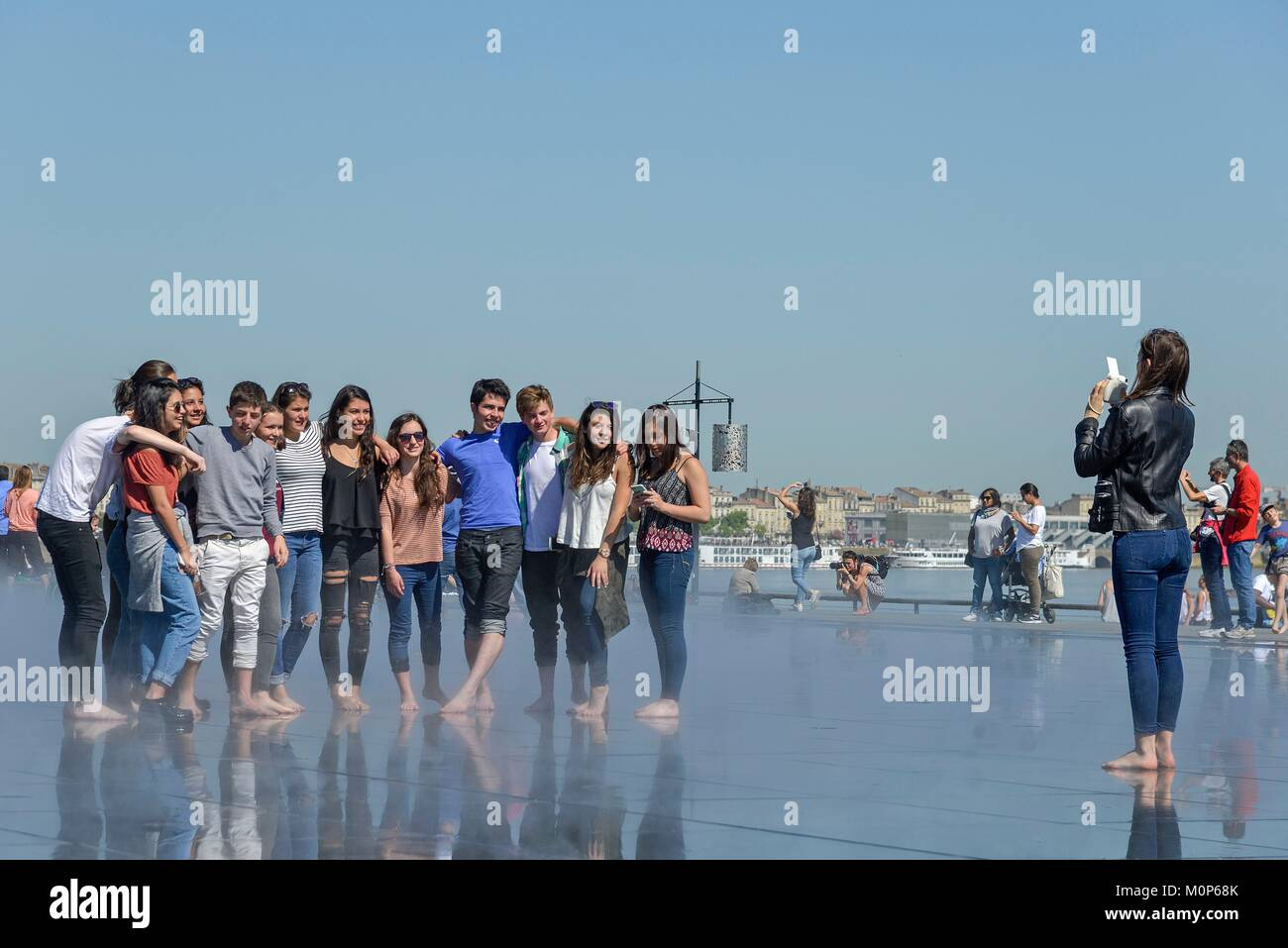France,Gironde,Bordeaux,Quay of Marshal Liautey,Ornamental pond,group of teenager photographing - Stock Image