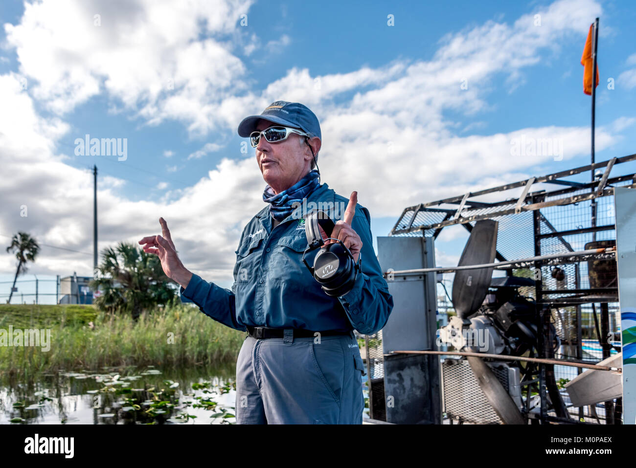 Woman airboat captain prepares her passengers at Sawgrass Recreation Park in the Florida Everglades near Fort Lauderdale. - Stock Image