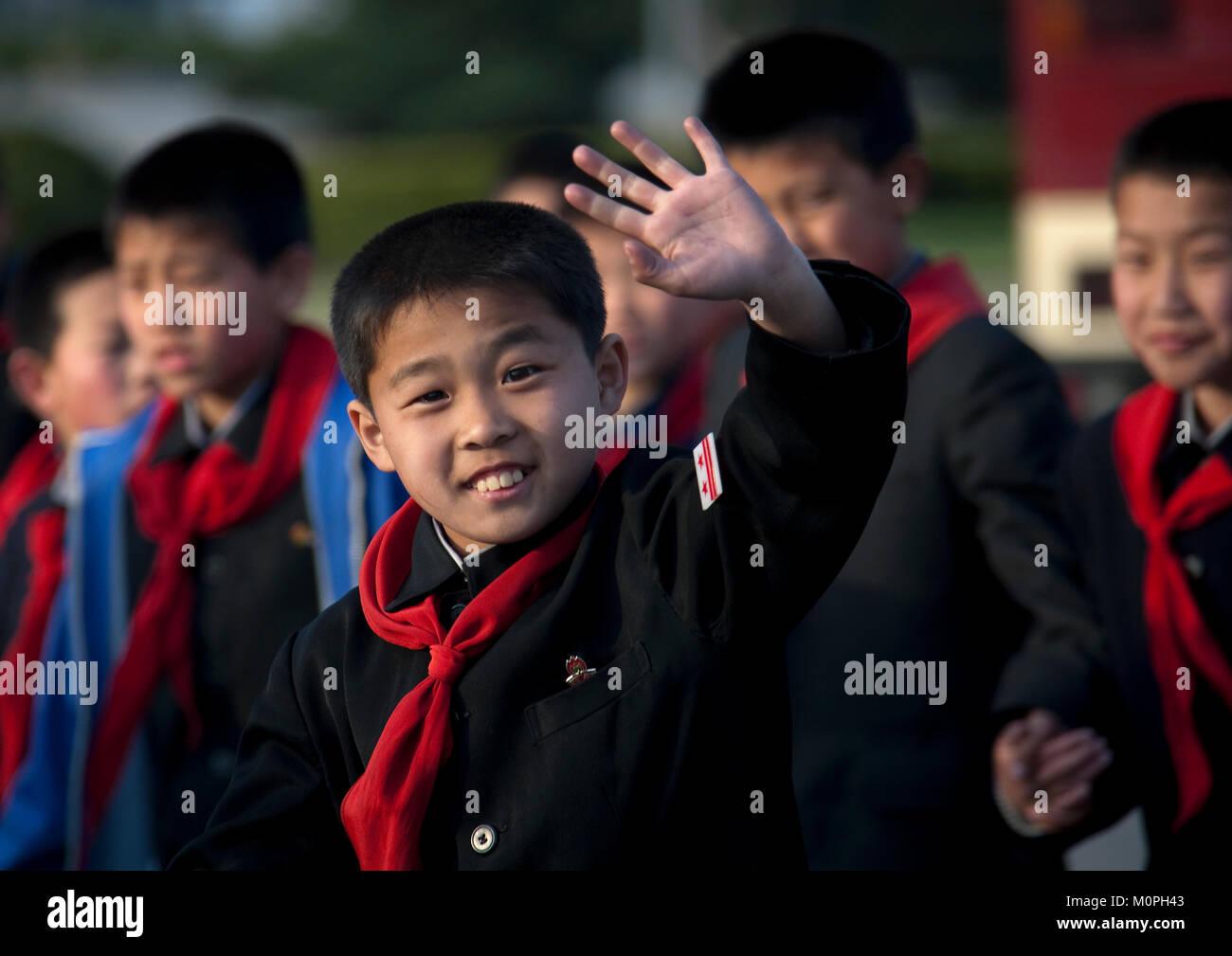 North Korean pioneer boy waving hand, Pyongan Province, Pyongyang, North Korea Stock Photo