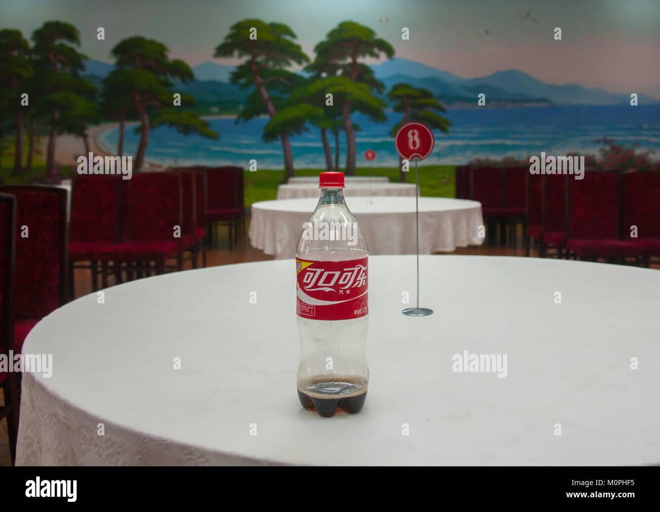Chinese Coca Cola Bottle On The Table Of An Empty Restaurant South