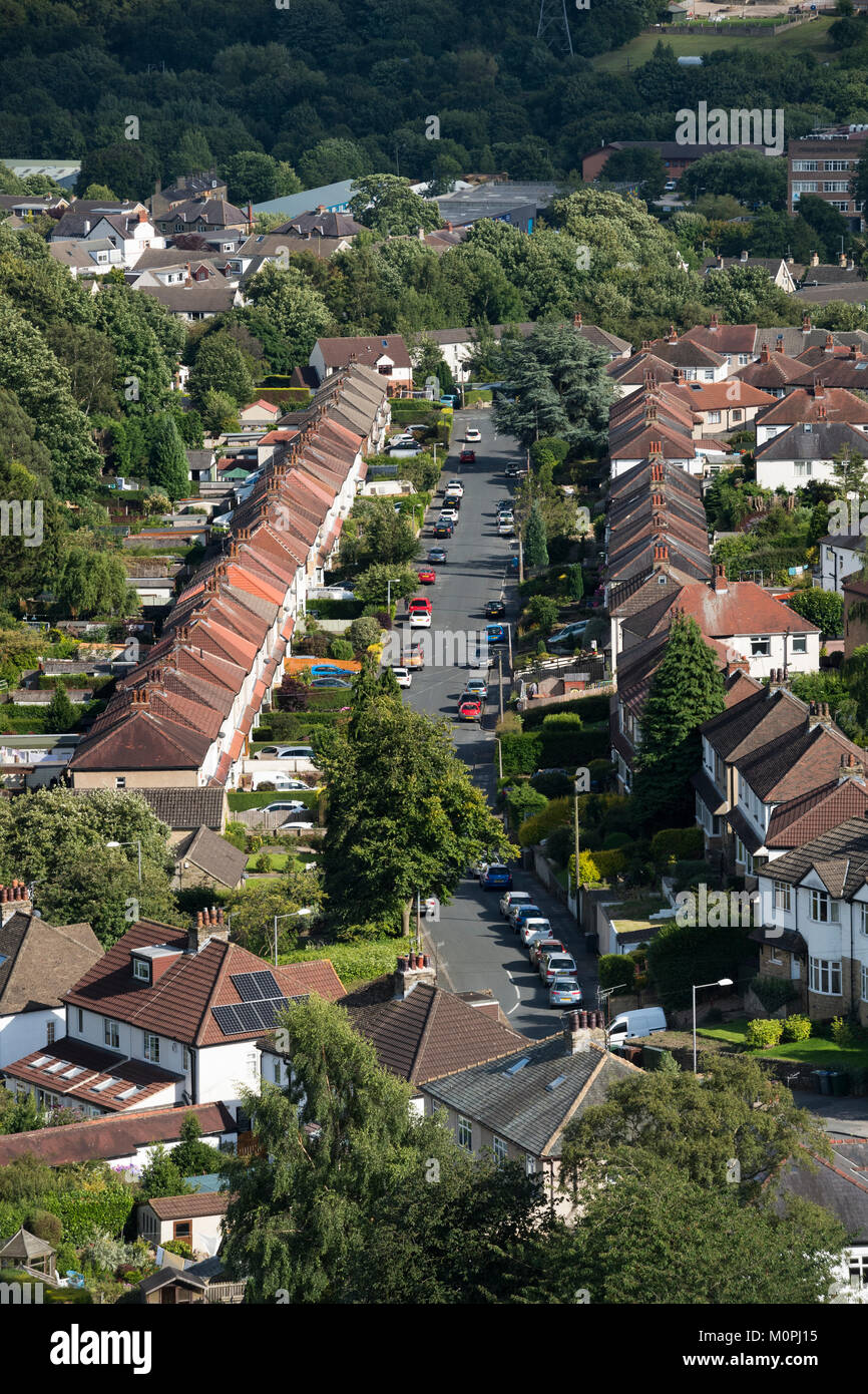 High view of area of Baildon town, with straight road of semi-detached houses in residential urban suburb - Bradford, - Stock Image