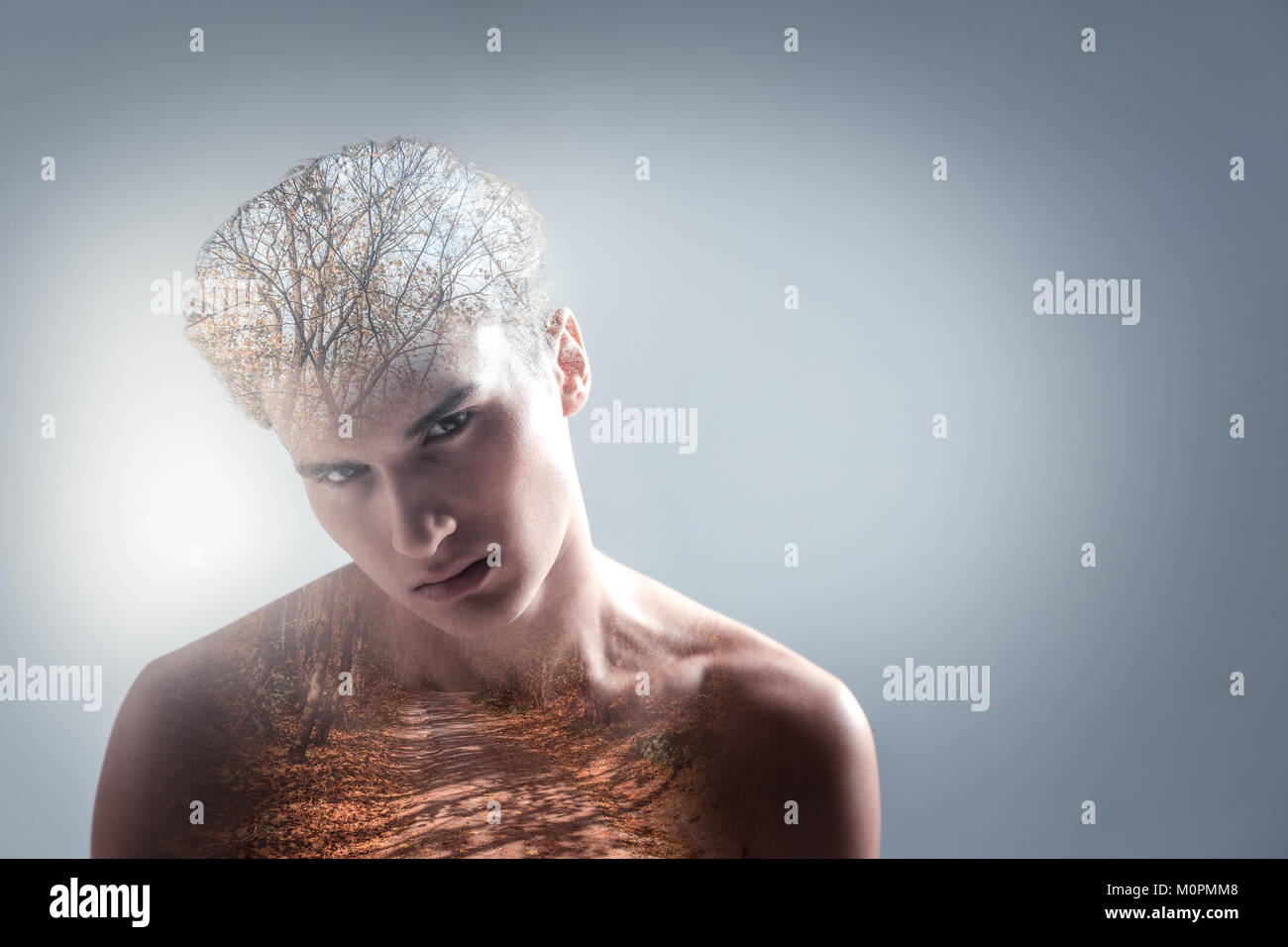 Focused young guy estimating level of his creativity - Stock Image