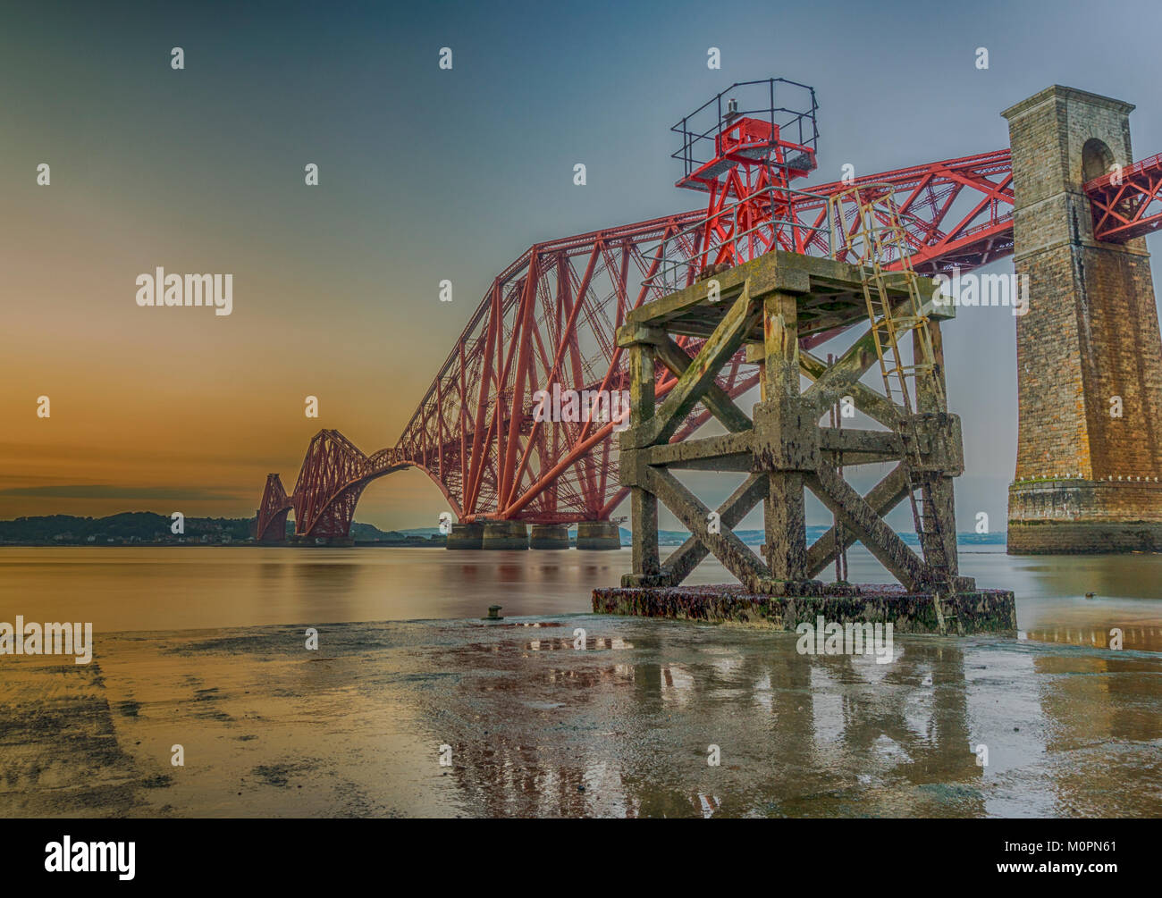 The Forth Bridge, taken from the very bottom of Hawes Pier, South Queensferry. The pier was built around 1812. In - Stock Image