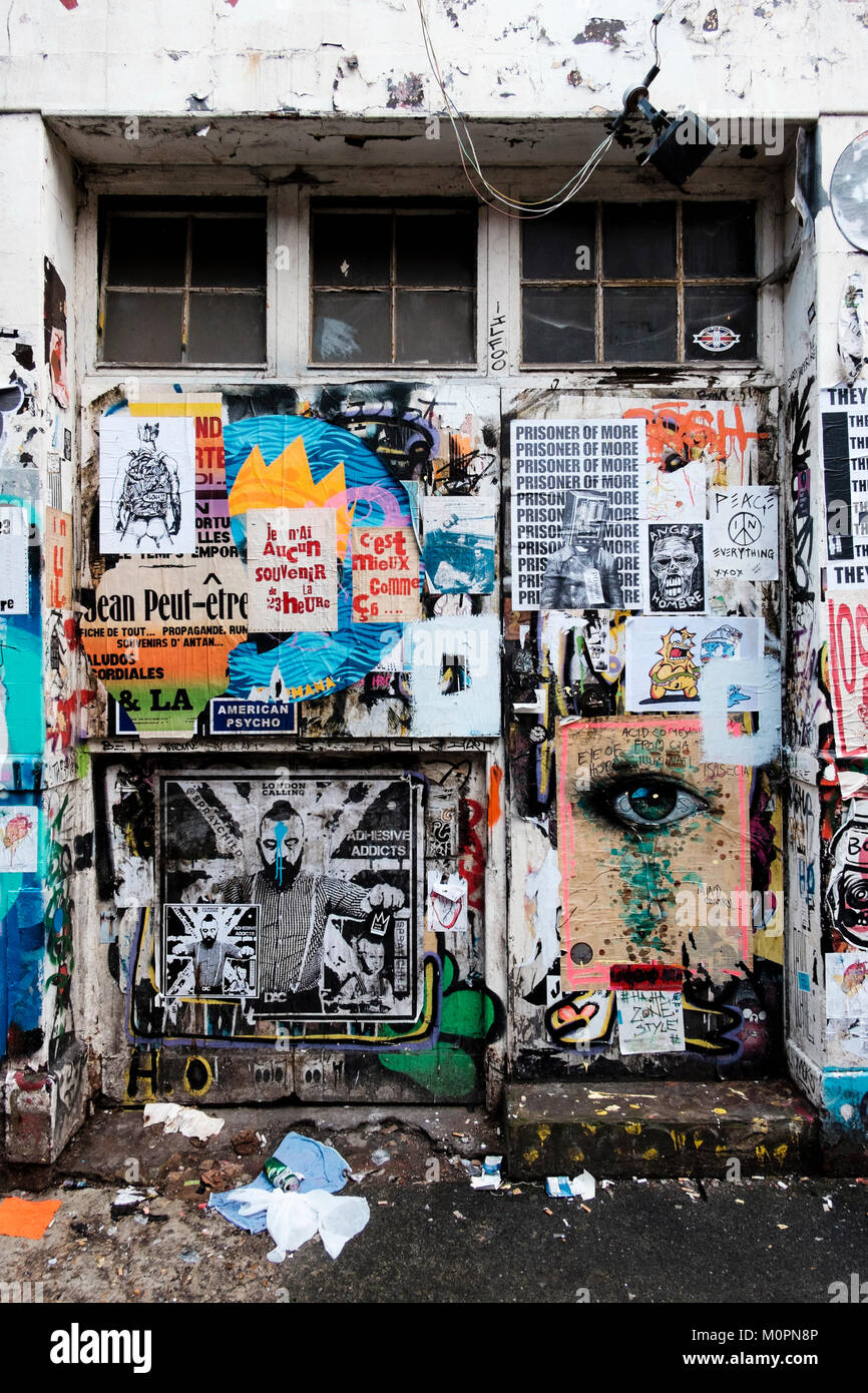 London urban photography: Wall covered with fly posters, Brick Lane, East London. - Stock Image