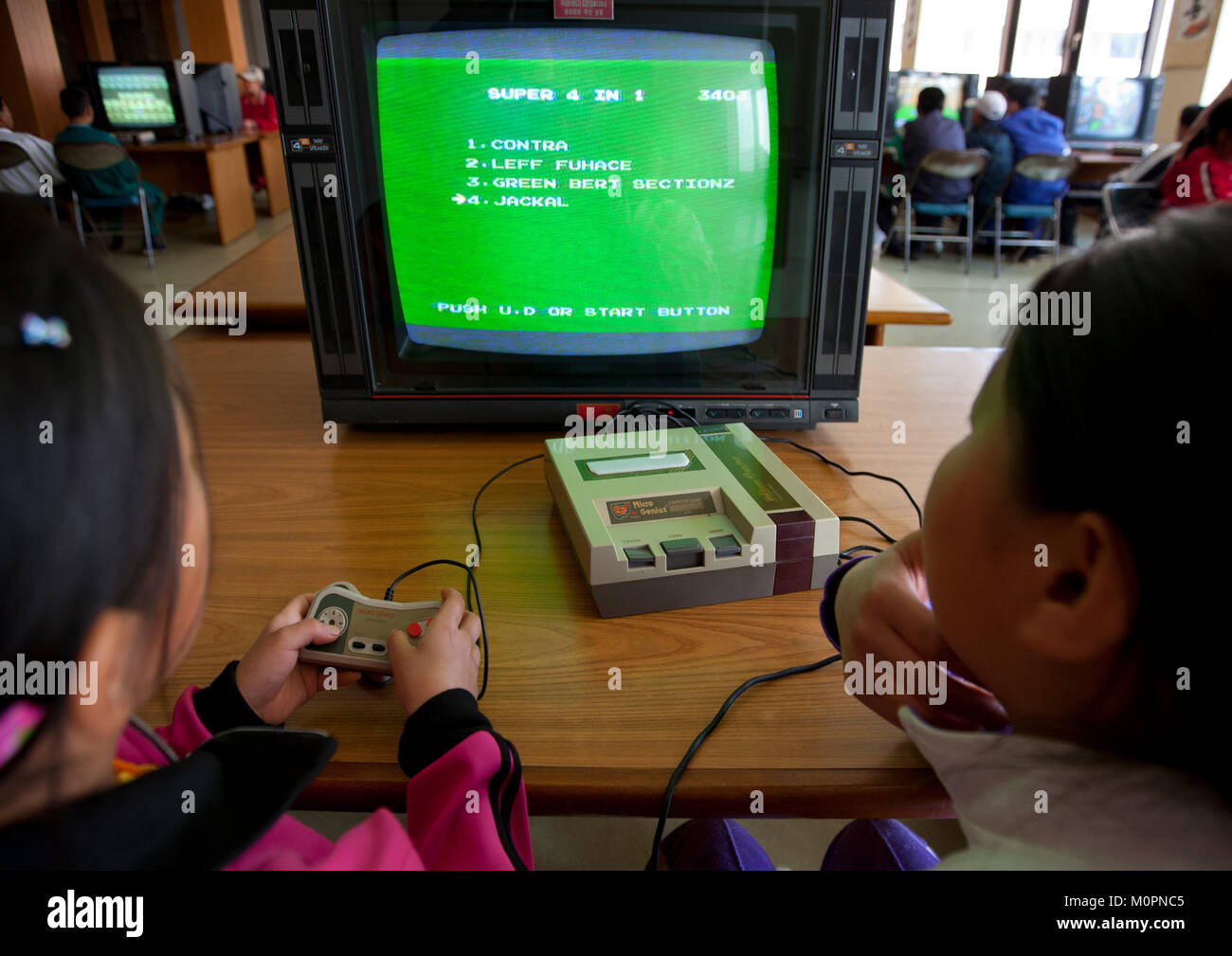 North Korean children playing video games in Songdowon international children's camp, Kangwon Province, Wonsan, Stock Photo