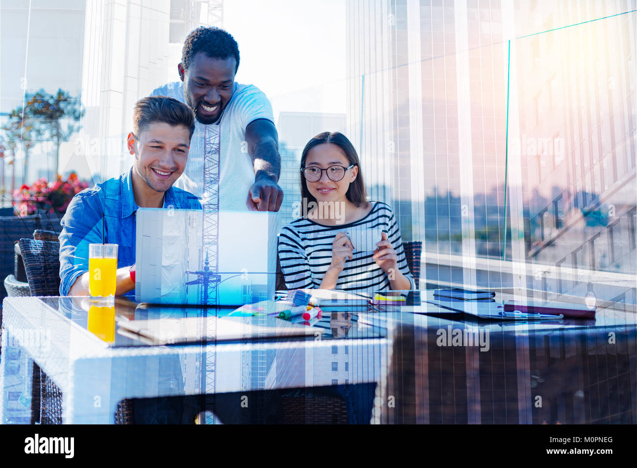 Exuberant young people working together - Stock Image