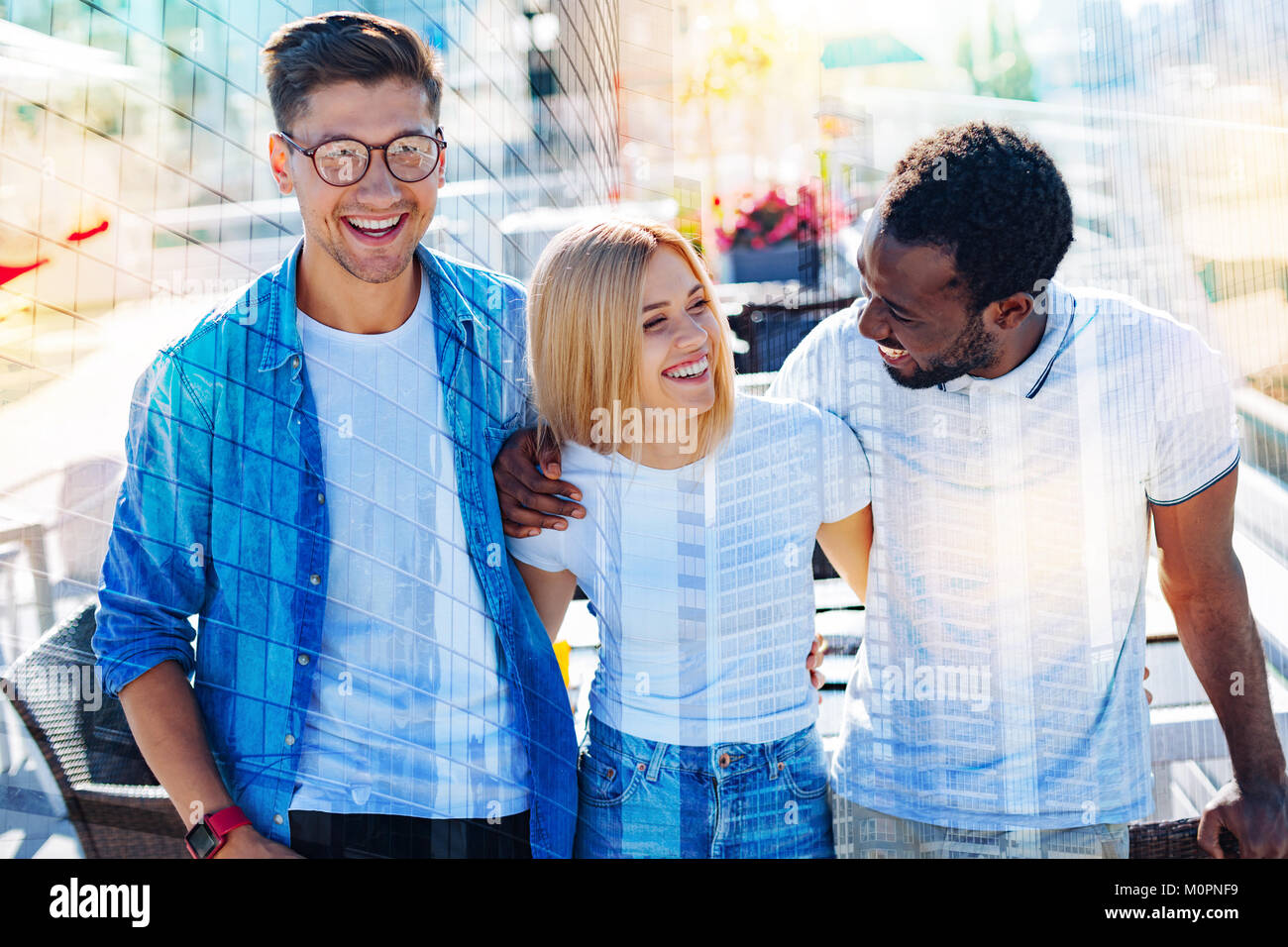 Smiling young people working together - Stock Image