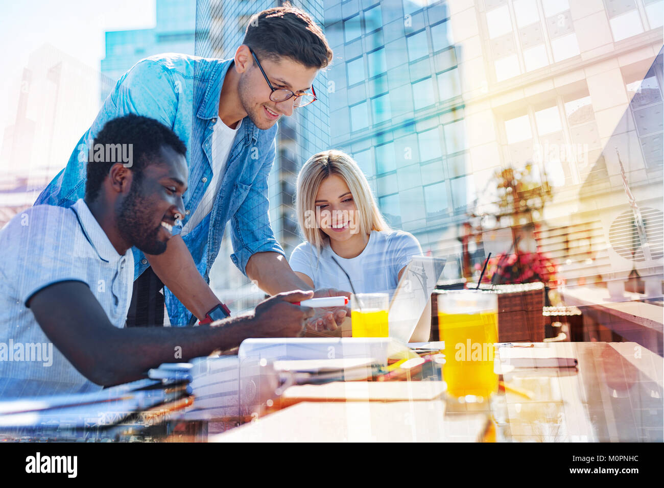 Content co-workers discussing the project - Stock Image