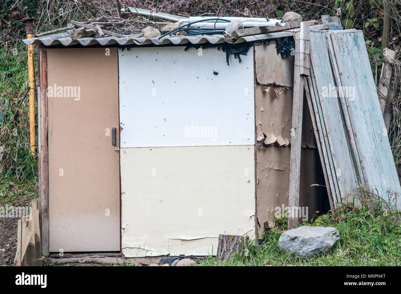 old barrack made with recycled material - Stock Image