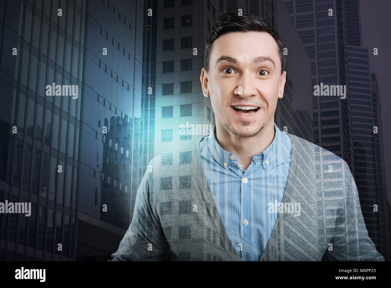 Positive minded young man getting excited - Stock Image