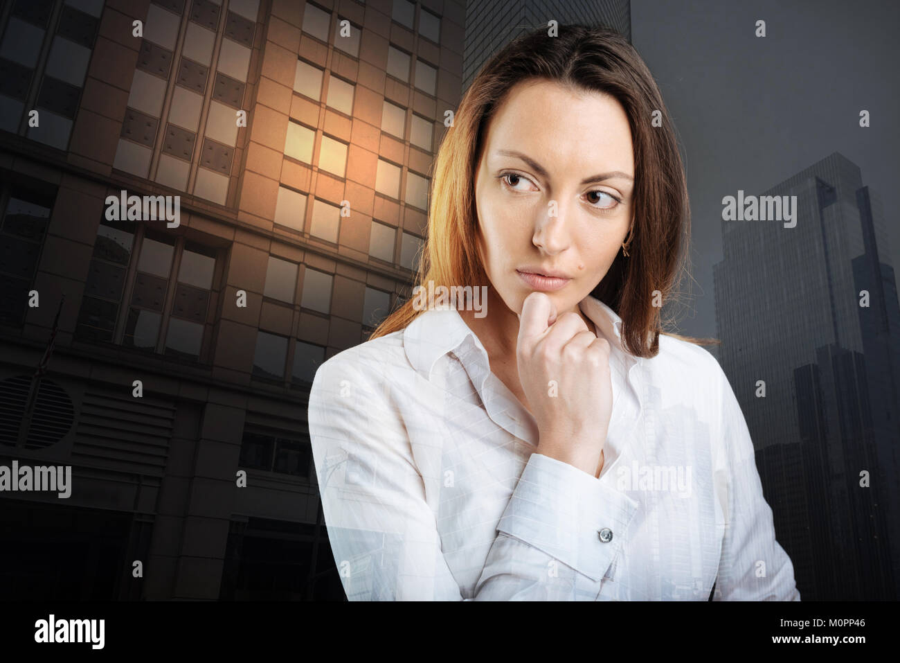 Pensive young woman thinking about something serious - Stock Image