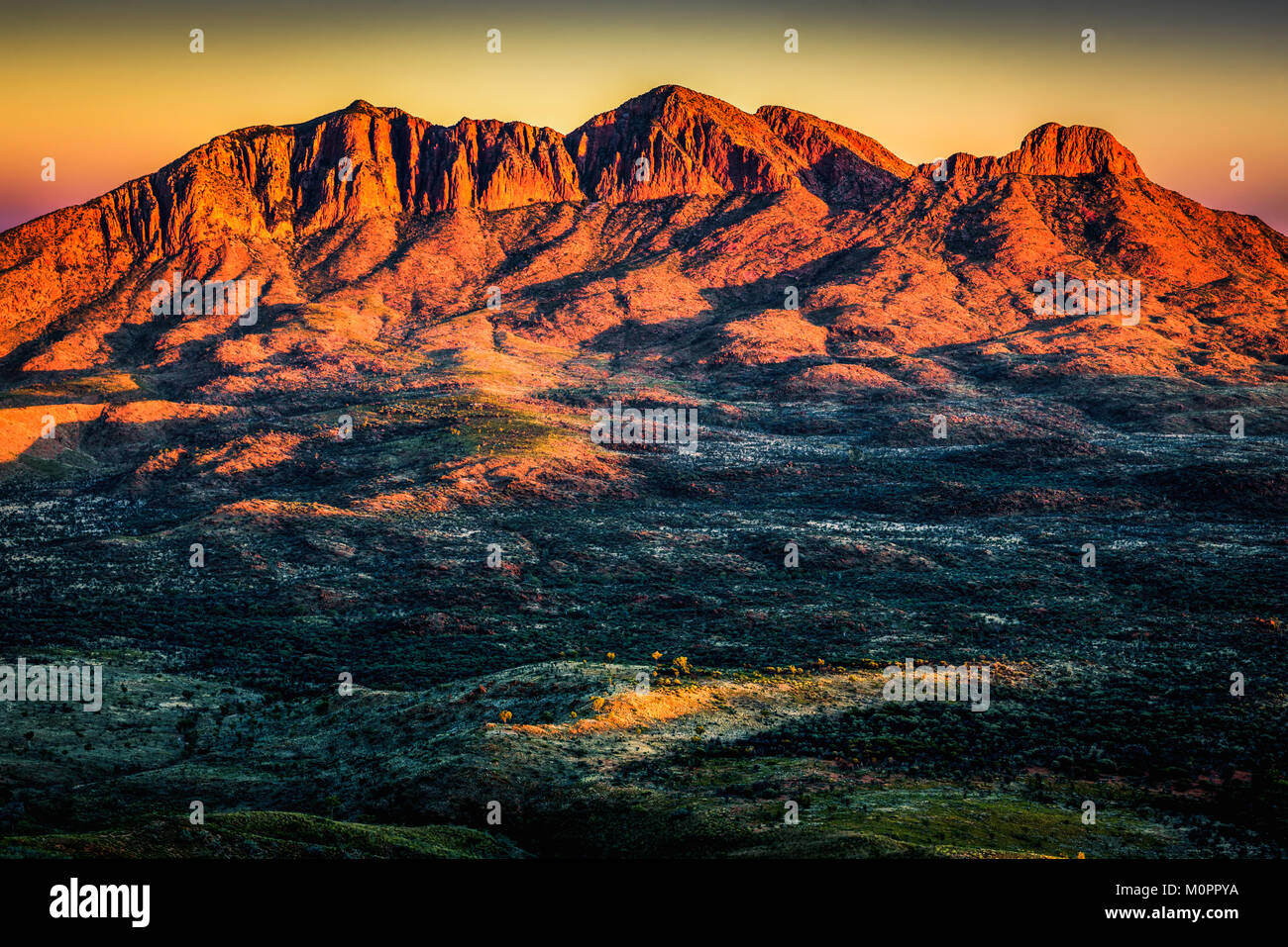 Mount Sonder from Hilltop Lookout at Sunrise. West Macdonnell Ranges, Northern Territory - Stock Image