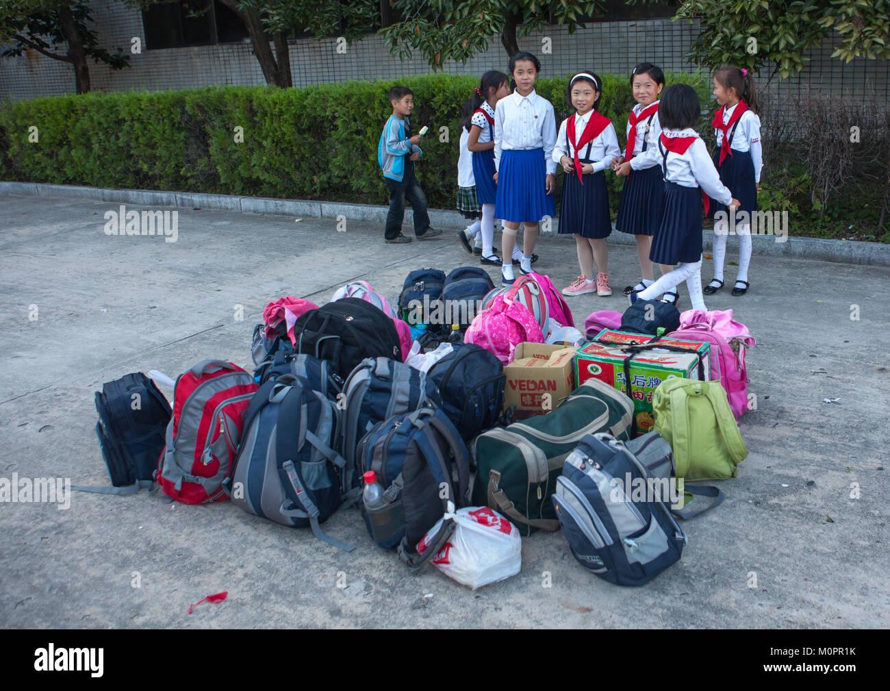 North Korean pioneers arriving in Songdowon international children's camp, Kangwon Province, Wonsan, North Korea - Stock Image