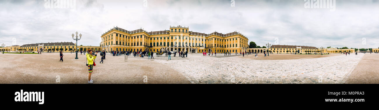 Unidentified people walking around Schonbrunn Palace in Vienna - Stock Image