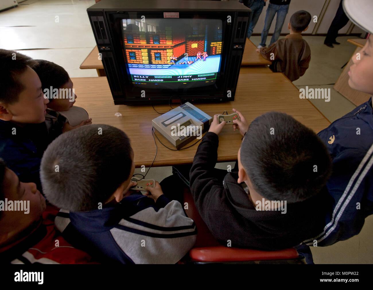 North Korean children playing video games in Songdowon international children's camp, Kangwon Province, Wonsan, - Stock Image