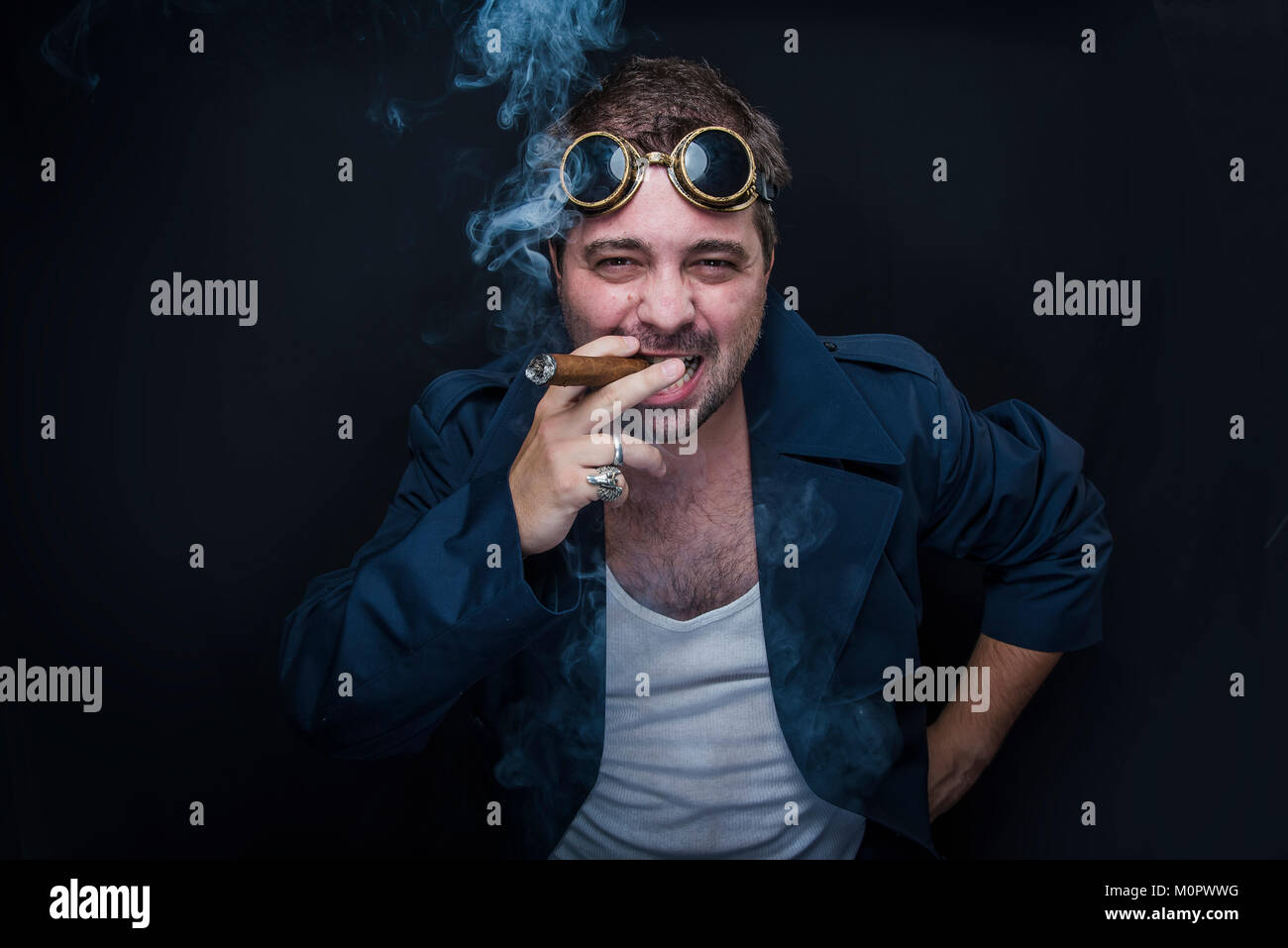 Steampunk smoker with a cuban cigar Stock Photo
