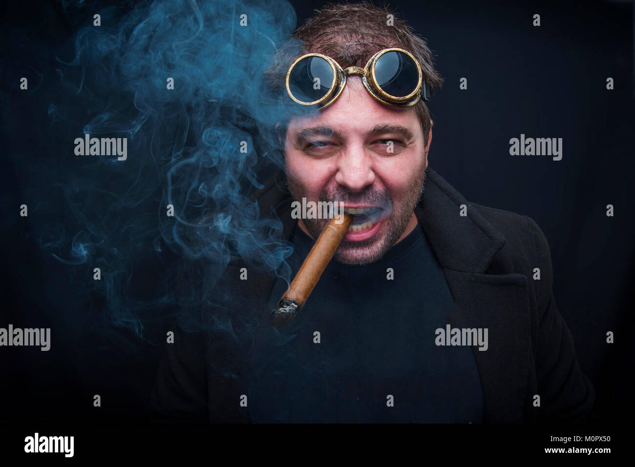Steampunk smoker with a cuban cigar - Stock Image