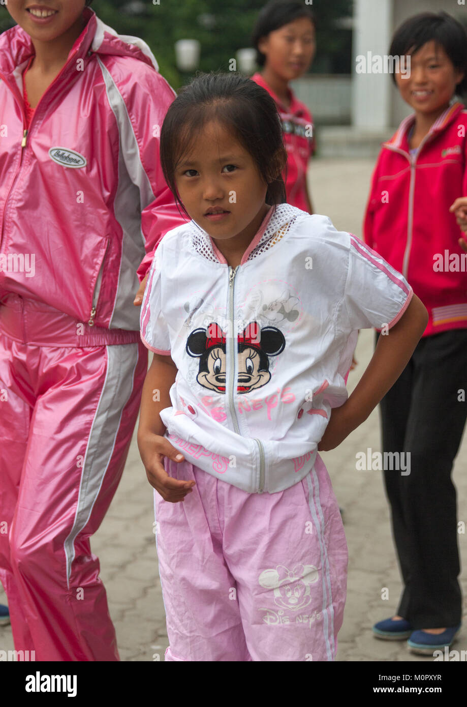 Young North Korean girl with a Minnie mouse logo on her vest in the Songdowon international children's camp, Kangwon Stock Photo