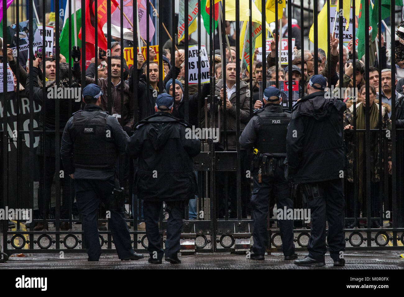 London, UK. 23rd Jan, 2018. Supporters of the Kurdish People's Council of Britain protest outside Downing Street Stock Photo