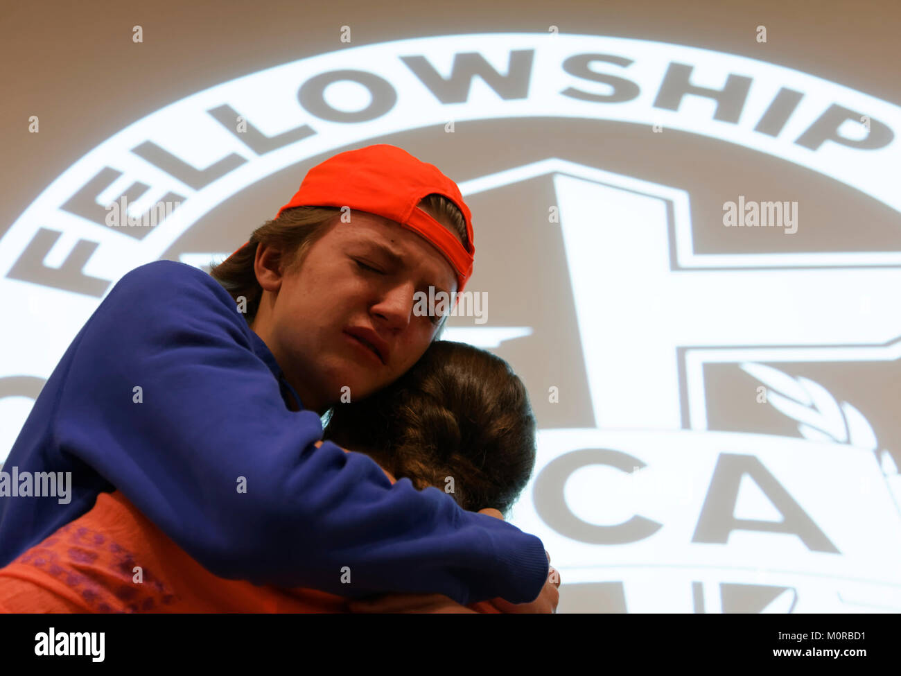 99758fd7763 An unidentified young man and woman hug after McCracken County High School  students