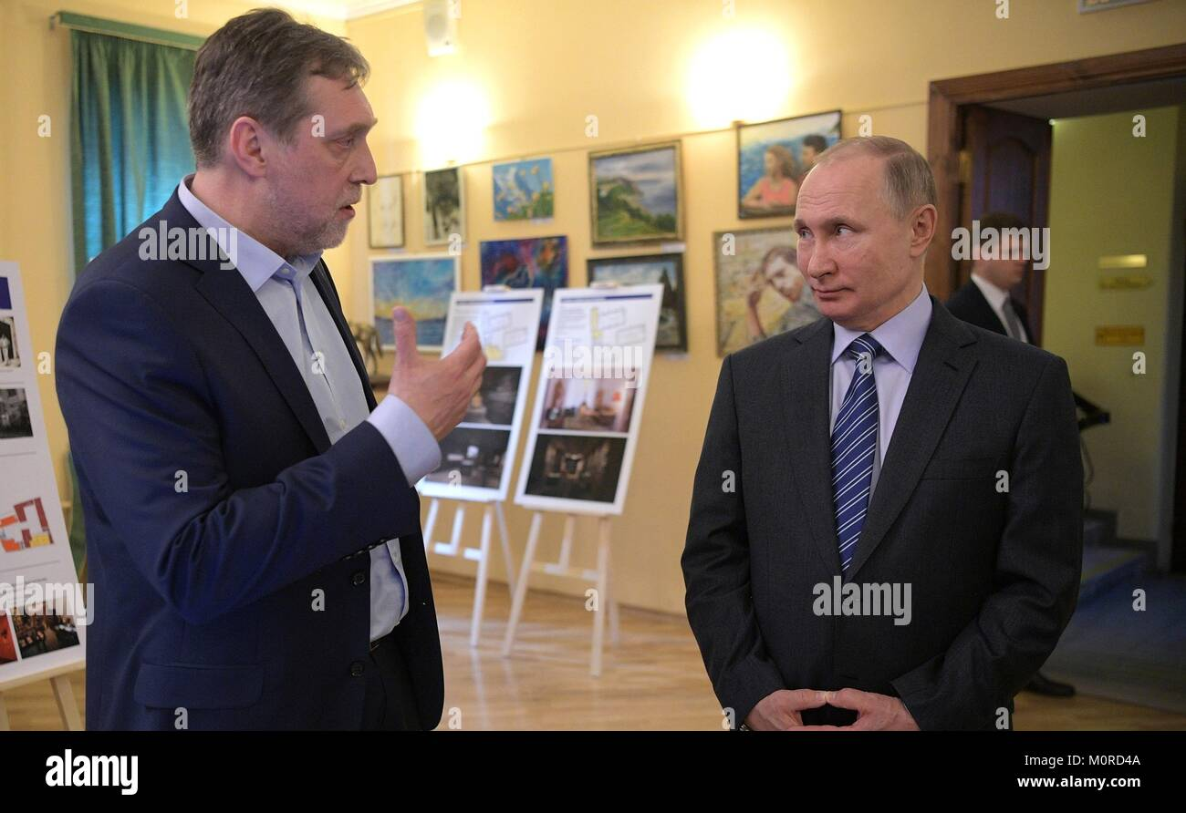 Russian President Vladimir Putin, right, tours the Vysotsky House in Taganka Museum Centre with Museum Director - Stock Image