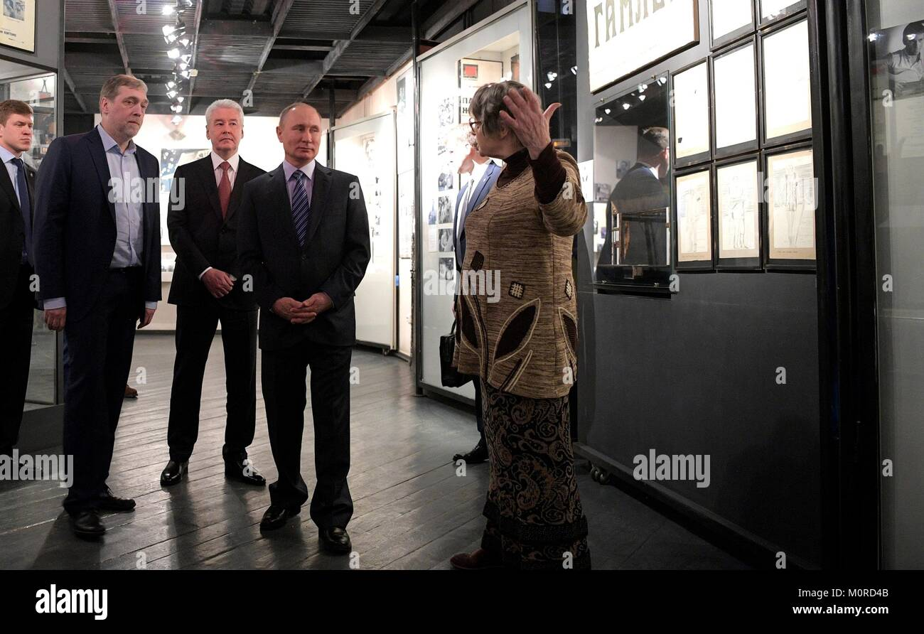 Russian President Vladimir Putin, center, tours the Vysotsky House in Taganka Museum Centre with Museum Director - Stock Image