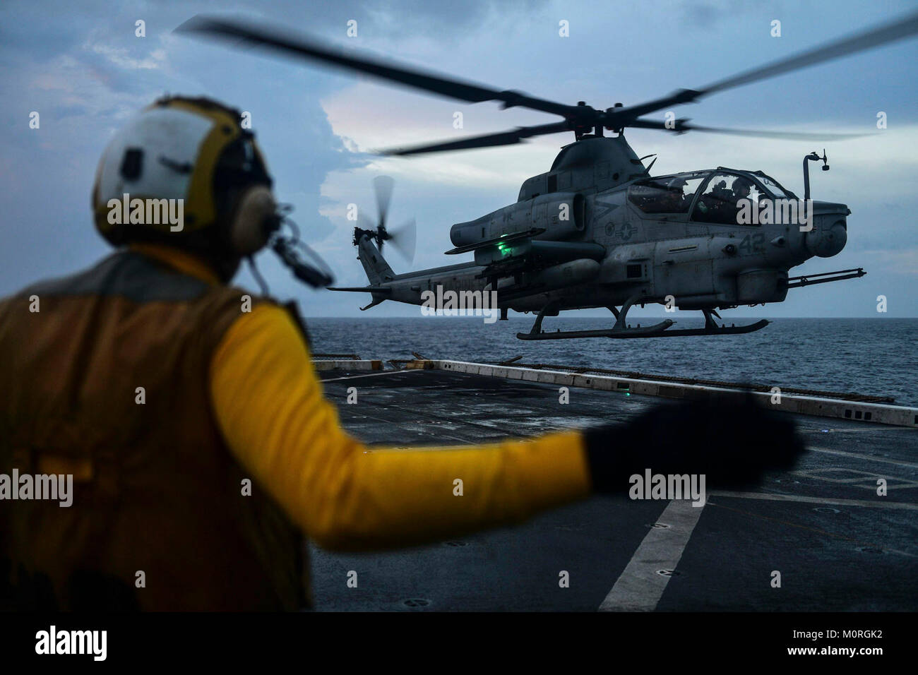 INDIAN OCEAN (Dec. 30, 2017) Aviation Boatswain Mate Handling Airman Ryan Sharland, from Newport Beach, Calif., directs a AH-1Z Viper attack helicopter, attached to Marine Medium Tiltrotor Squadron (VMM) 161 (reinforced), on the flight deck of the amphibious transport dock ship USS San Diego (LPD 22). San Diego, part of the America Amphibious Ready Group, with embarked 15th MEU, is operating in the Indo-Asia-Pacific region to strengthen partnerships and serve as a ready-response force for any type of contingency. (U.S. Navy Stock Photo