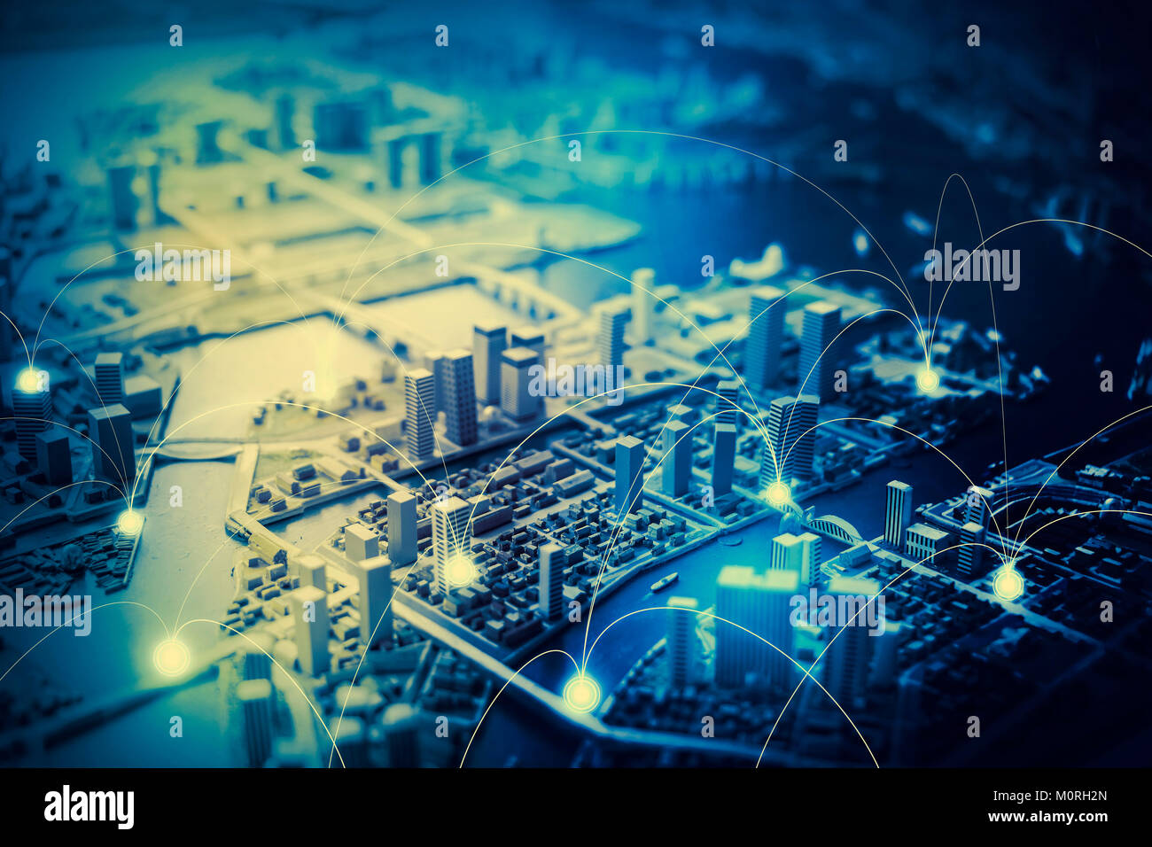 duotone graphic of smart city diorama and communication network concept IoT(Internet of Things), ICT(Information - Stock Image