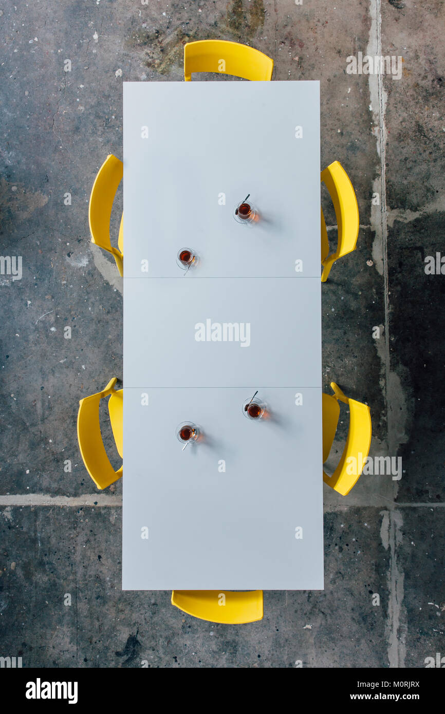 Conference table with turkish tea cups seen from above Stock Photo