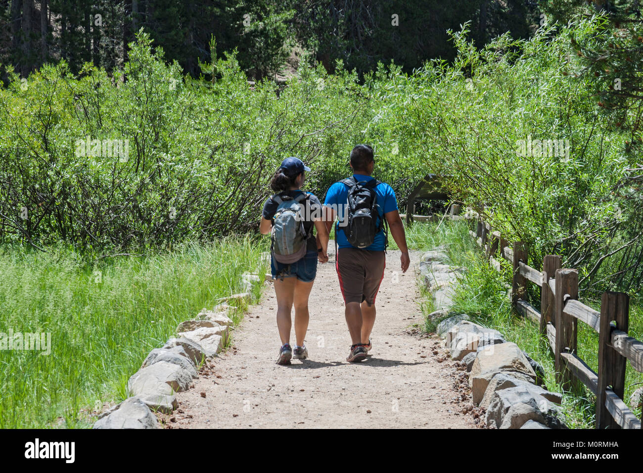 Hikers in Devils Postpile National Monument, Inyo National Forest, Madera County, California, USA - Stock Image