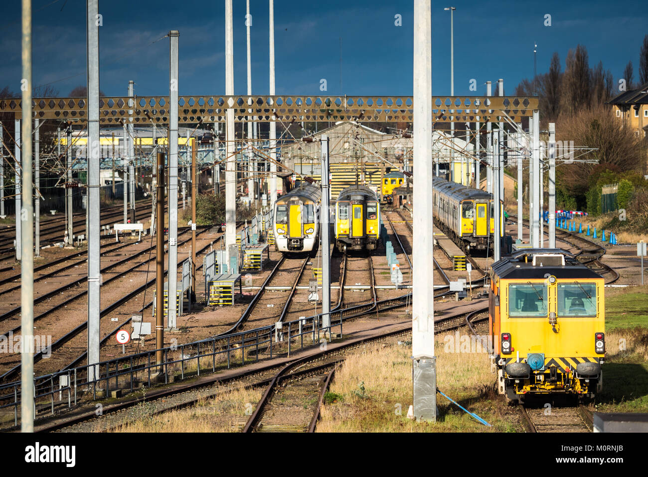 Greater Anglia Commuter trains wait in a siding outside Cambridge Station - Stock Image