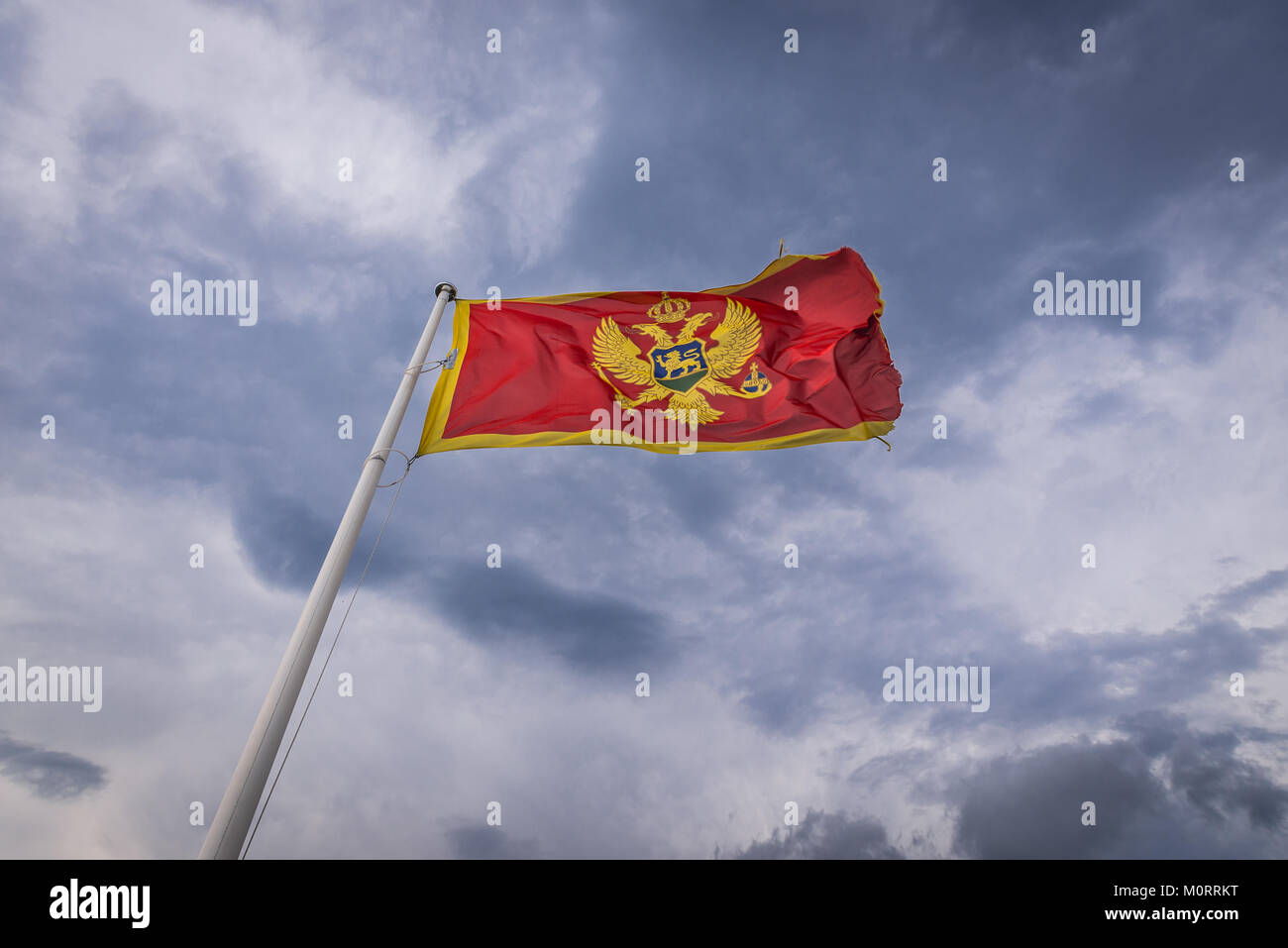 Montenegrin flag on Forte Mare fortress in Herceg Novi city on the Adriatic Sea coast in Montenegro Stock Photo