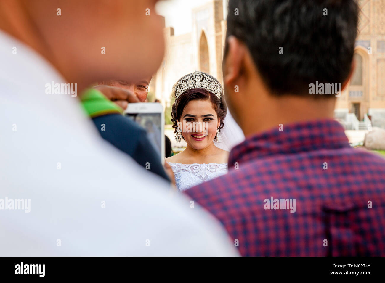 A 'Just Married' Young Couple Arrive At The Registan Complex For Their Wedding Photos, Samarkand, Uzbekistan - Stock Image