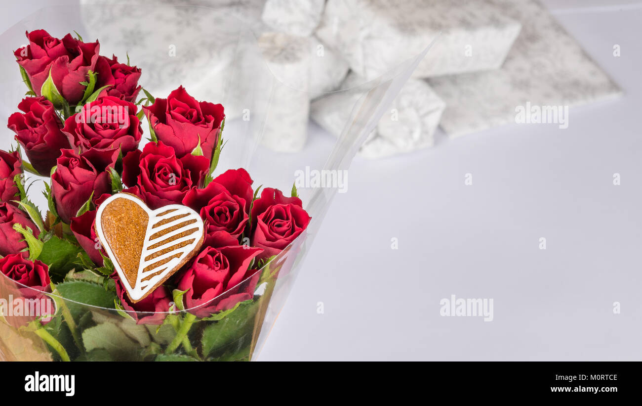 Bouquet of red roses and sweet heart for good luckcorative bouquet of red roses and sweet heart for good luckcorative flowers with white gifts in background celebration birthday anniversary valentine izmirmasajfo
