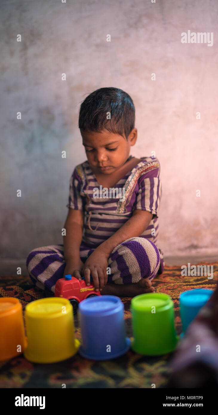 a portrait of a young Indian child at a nursery run by Seva Mandir, a few hours out of Udaipur. We brought toys - Stock Image