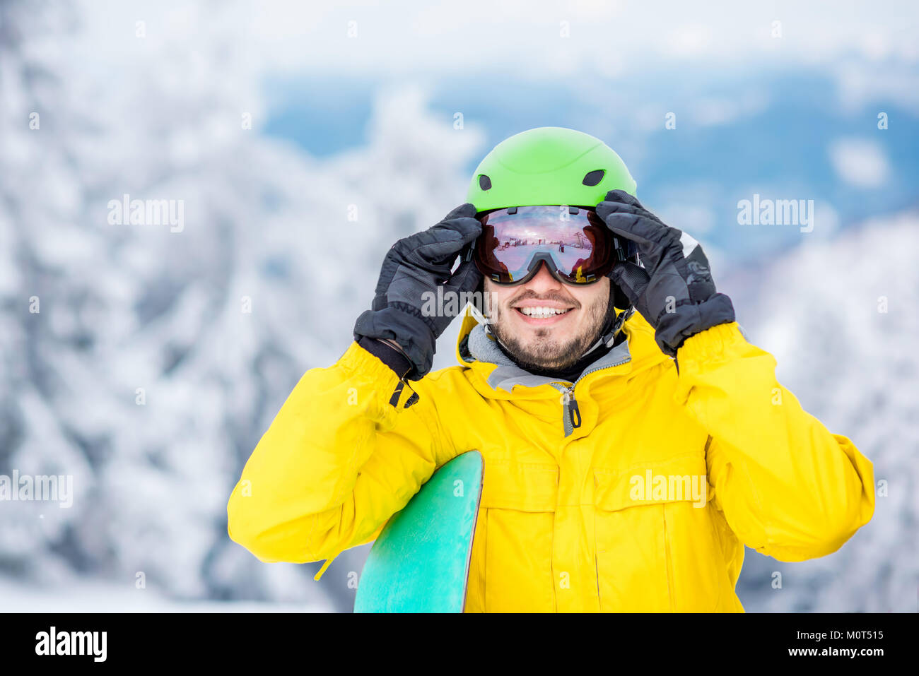 Man wearing sports glasses outdoors Stock Photo