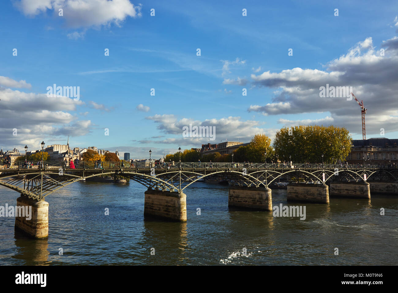 Paris,France - October 3 2017 : Ponts the Arts in Paris over the river Seine and people walking along the bridge - Stock Image