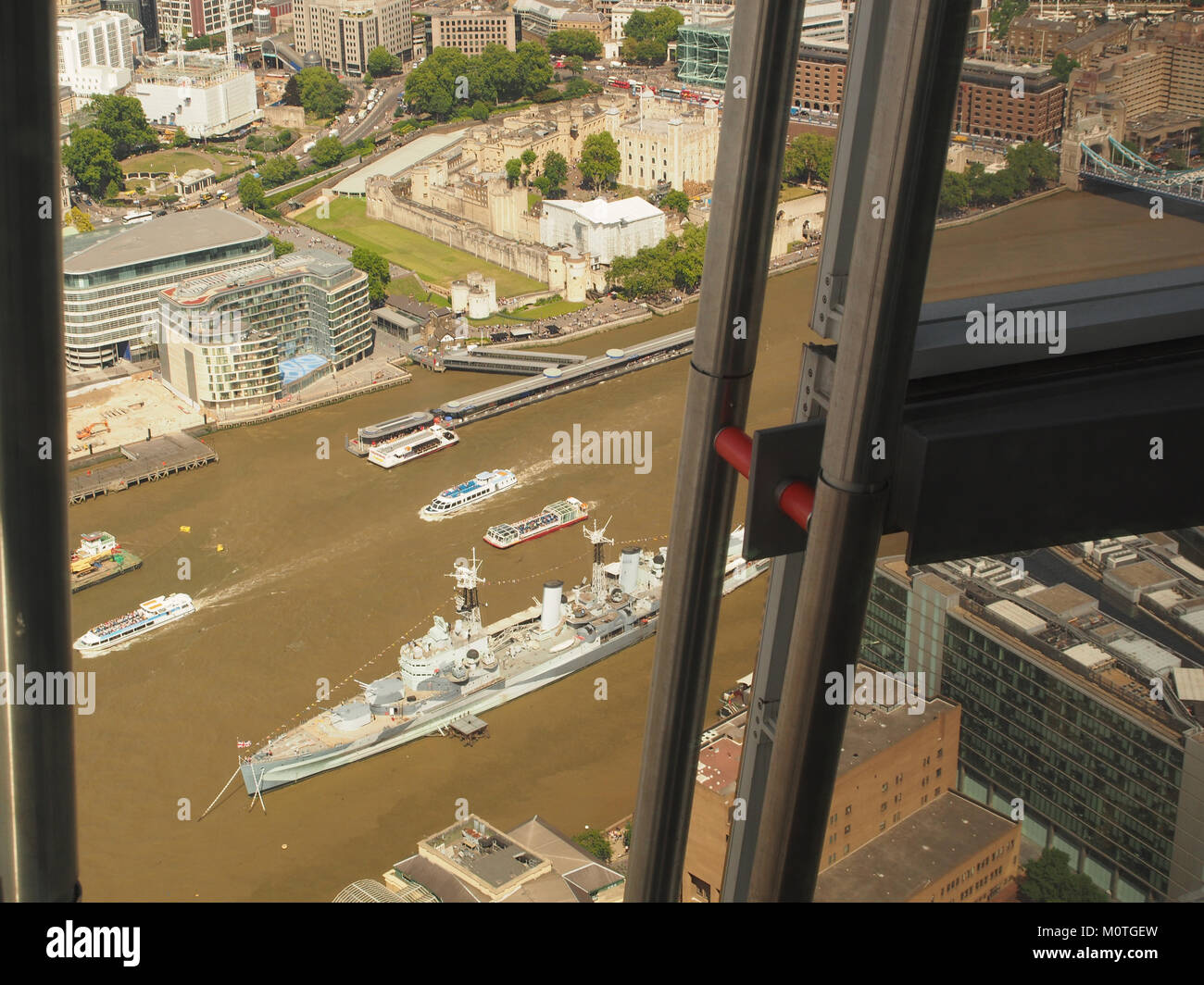 A view looking down from The Shard to the Pool of London with HMS Belfast and other vessels in sight and riverside - Stock Image