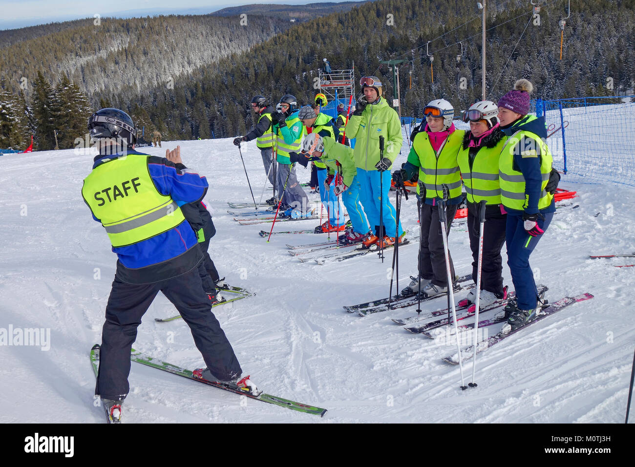A man takes photo of his colleges, ski resort staff, during active break at work.  Rogla ski resort. Pohorje. Zrece. - Stock Image