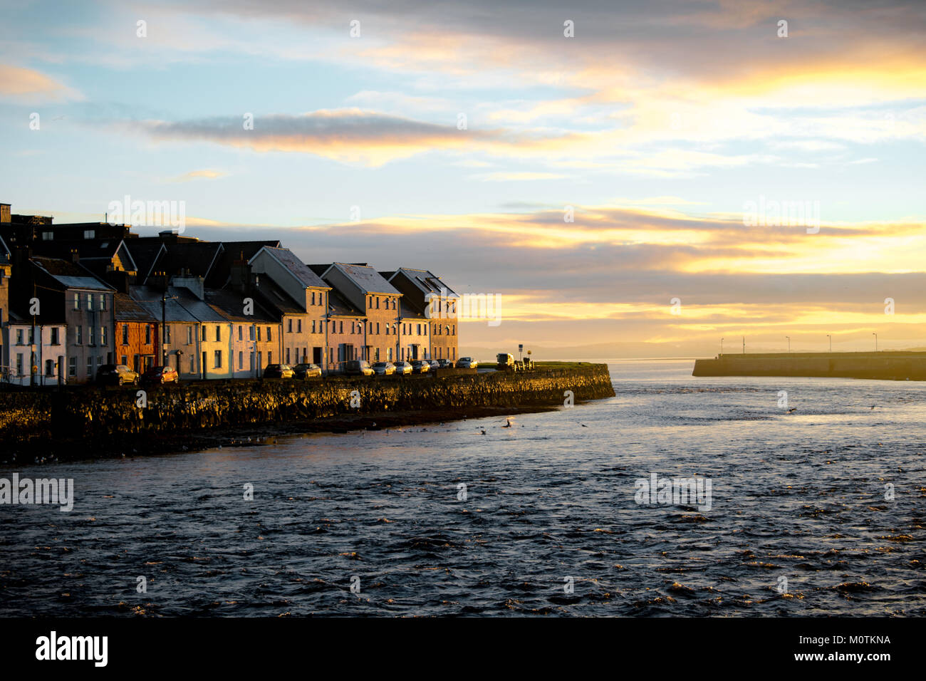 First morning light in Galway harbour - Stock Image