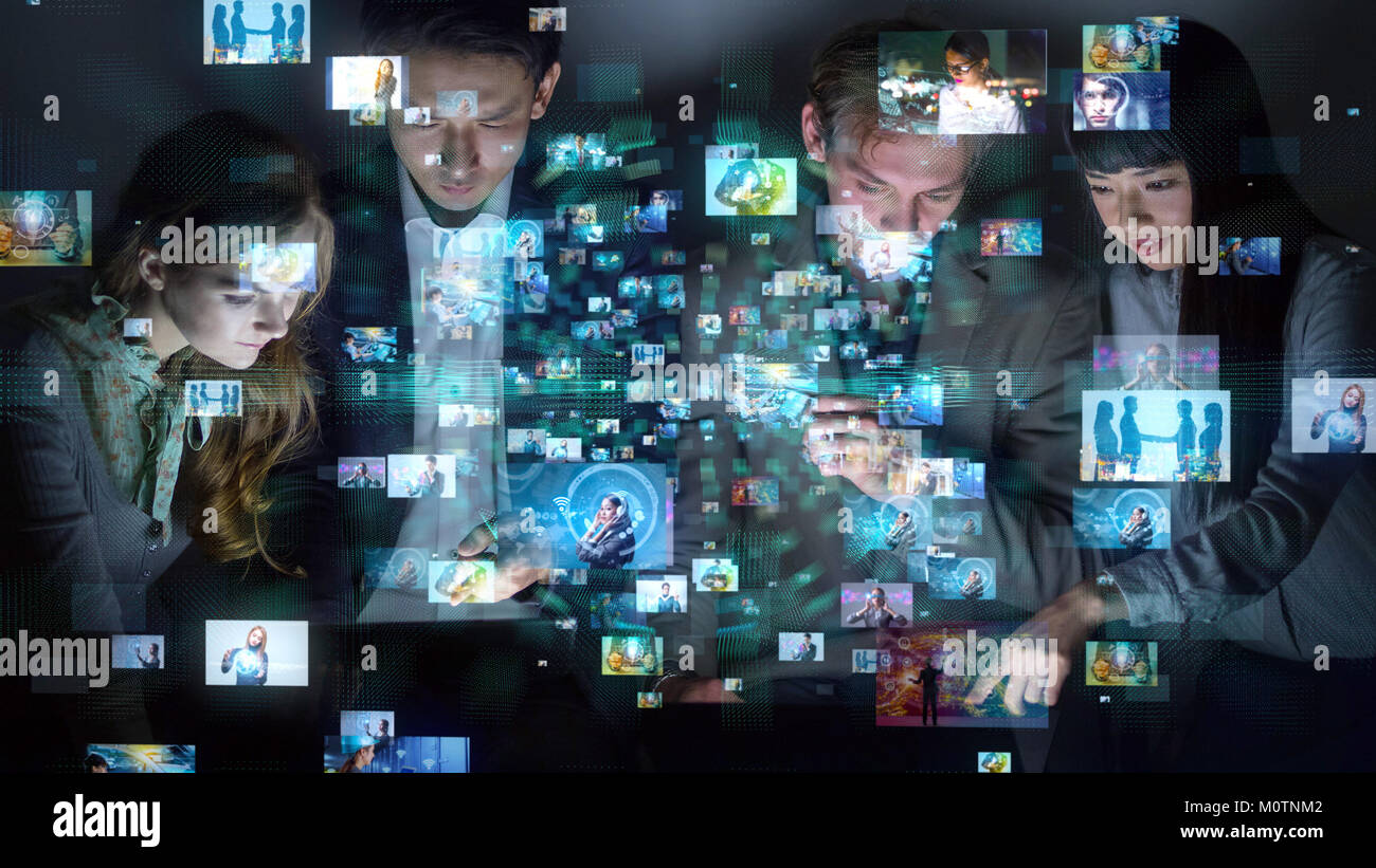 Group of people watching many pictures. - Stock Image