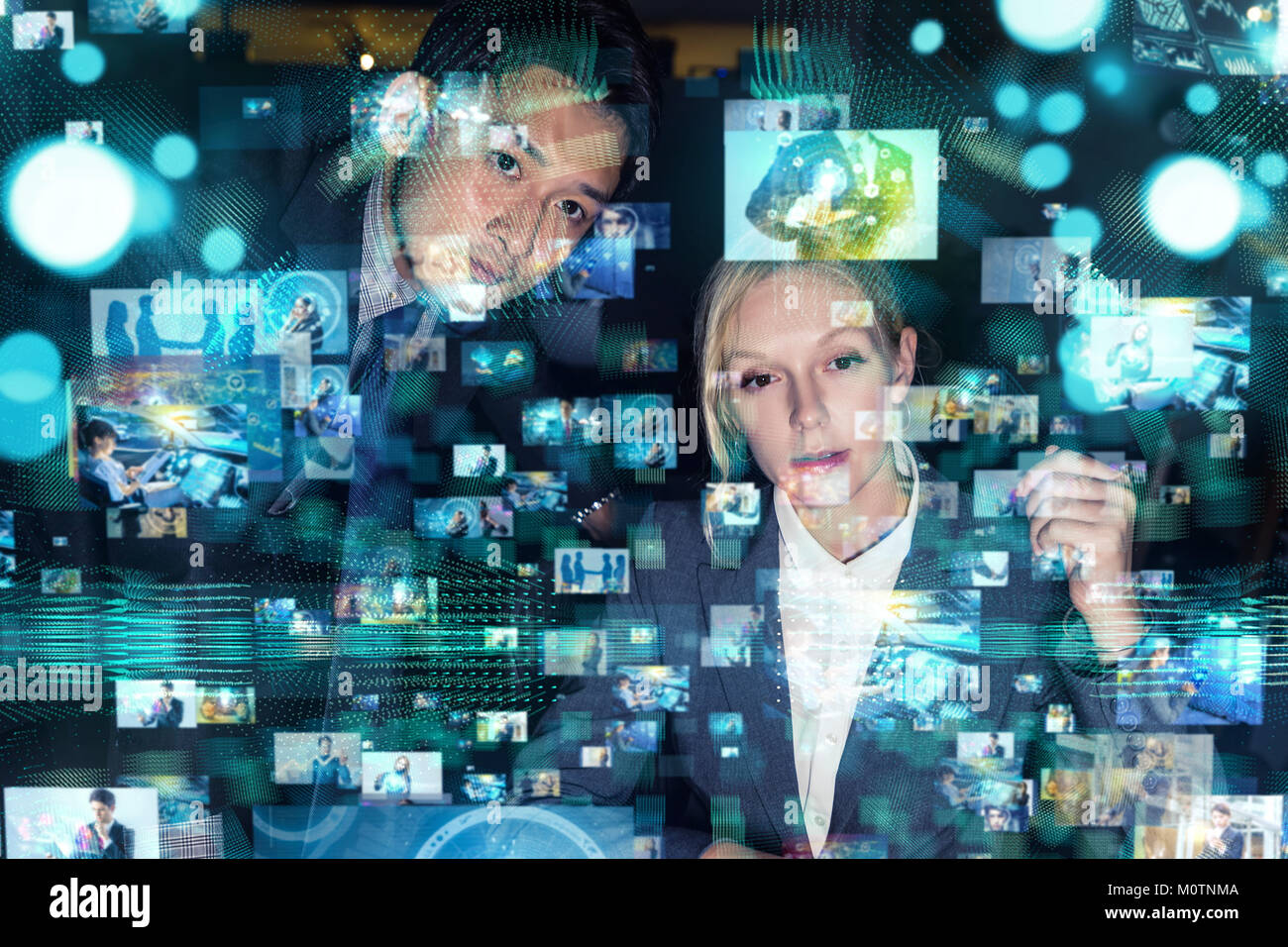 Young man and woman watching many pictures with stereoscopic vision. - Stock Image