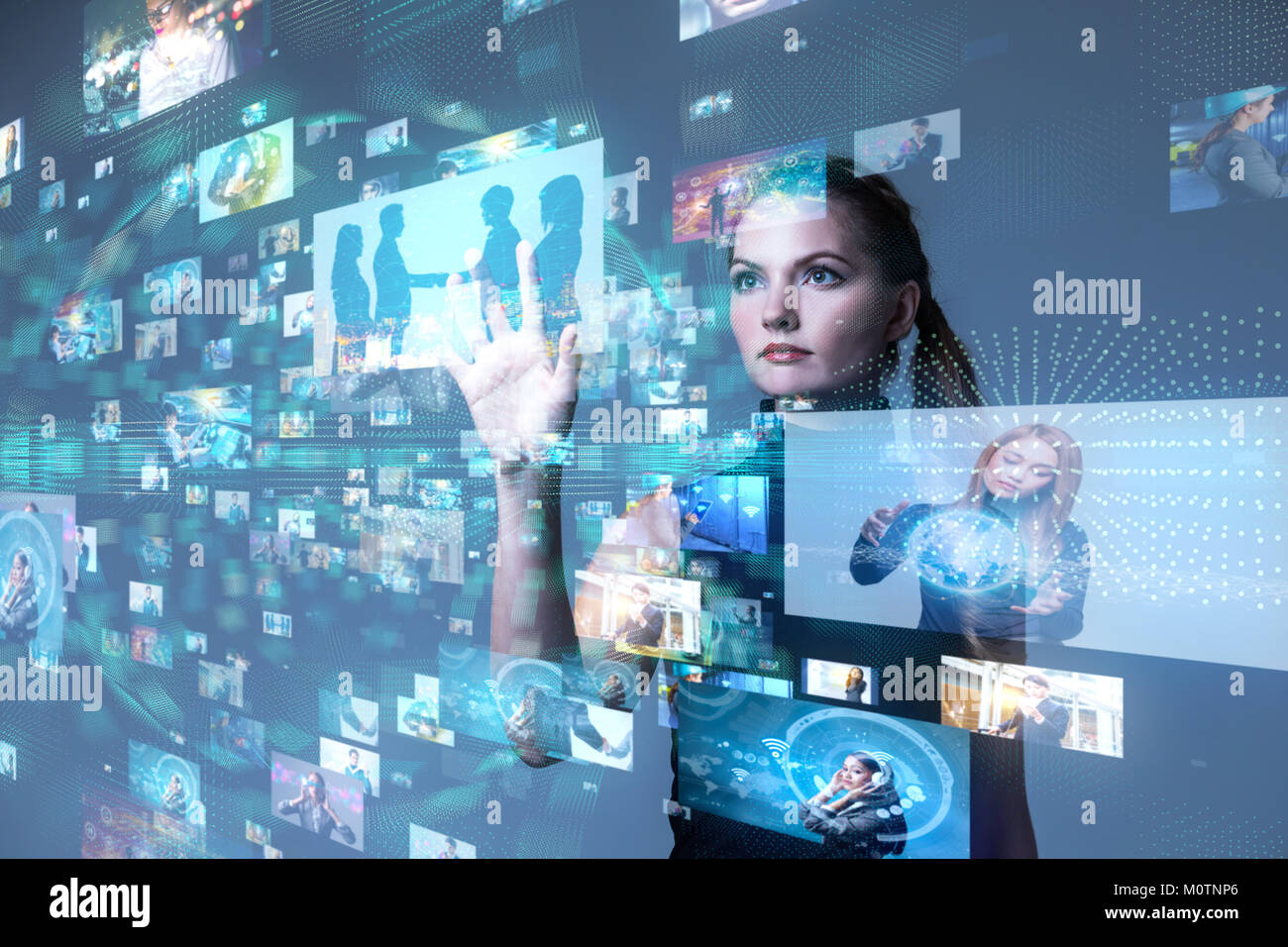 Young woman using futuristic interface. IoT(Internet of Things). ICT(Information Communication Network). Social Stock Photo