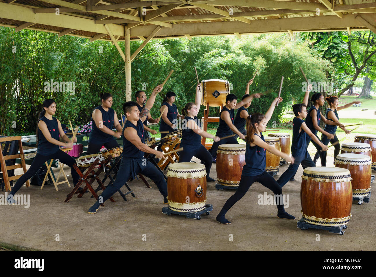 Taiko drummers perform in Lilioukalani Park in Hilo, Hawaii - Stock Image