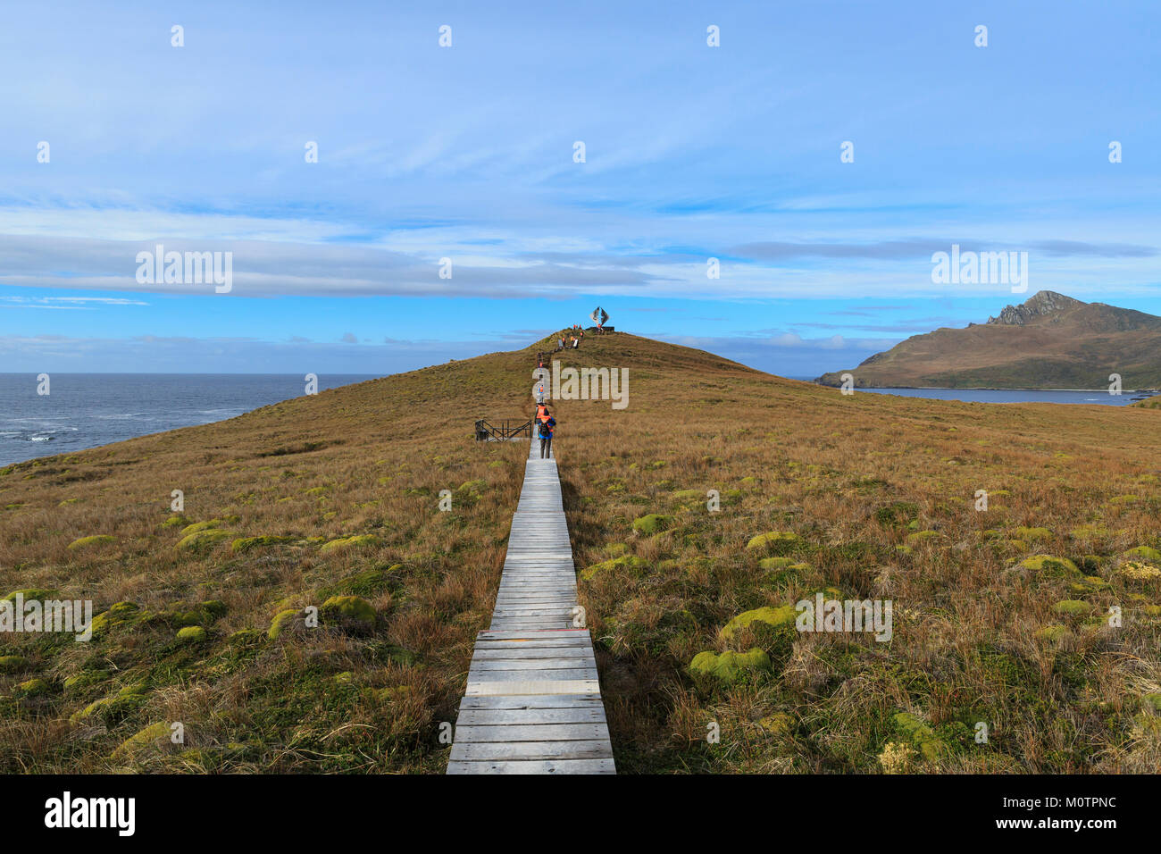 Tourist hike out to Albatross Memorial on Cape Horn, Tierra del Fuego, CHile - Stock Image