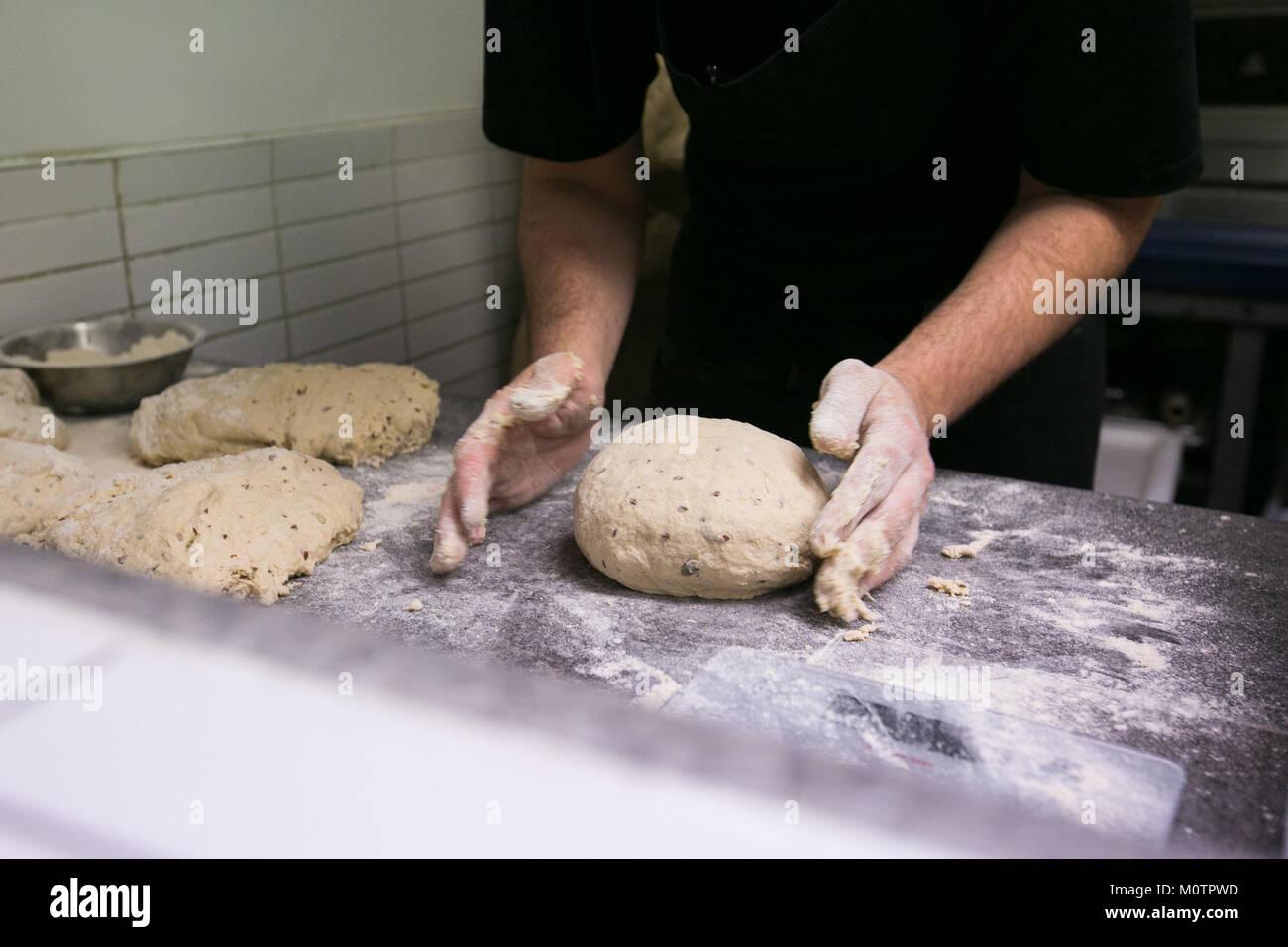 Artisan baker making bread - Stock Image