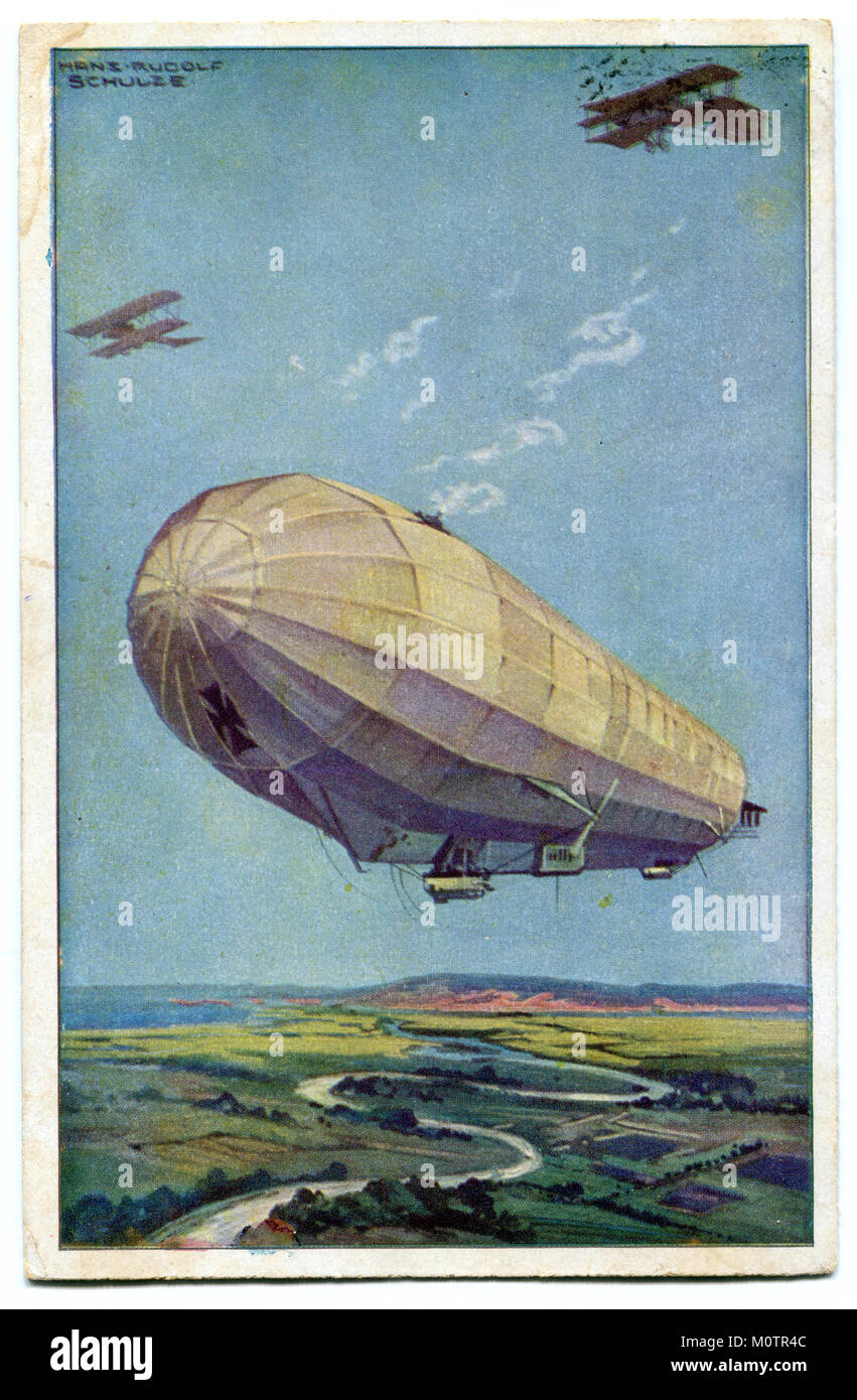 "Old German postcard ""The German air fleet"", a huge Zeppelin airship with two military airplanes flying in the air Stock Photo"