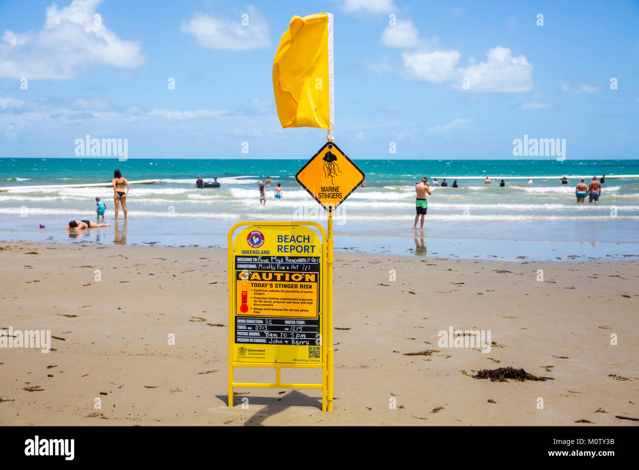 Four mile beach in Port Douglas, people swimming inside the stinger nets due to presence of box jellyfish stingers,Queensland,Australia - Stock Image
