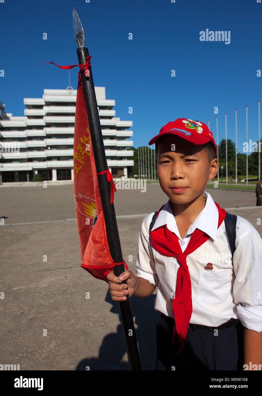 North Korean pioneer holding a flag in Songdowon international children's camp, Kangwon Province, Wonsan, North - Stock Image